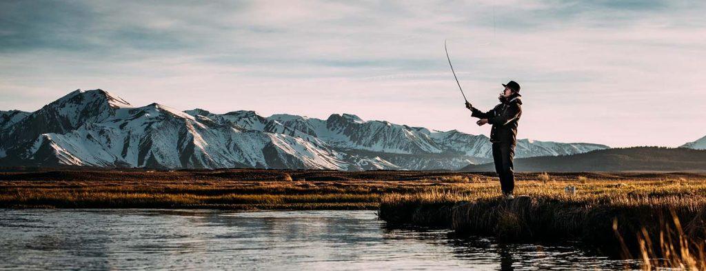 Man fishing on lake in winter - Fishing Gadget